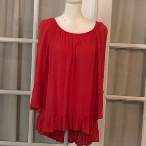 Orange shirt/blouse with ruffle.